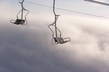 chairlift: Chairlift above the clouds