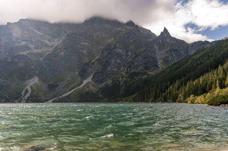 oko: Mountain lake during strong winds. Morskie Oko. Tatry Stock Photo