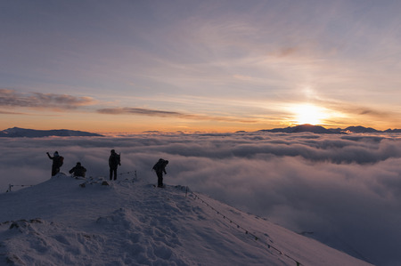 inversion: Winter inversion of clouds during the sunset viewed from the summit of the mountain Stock Photo