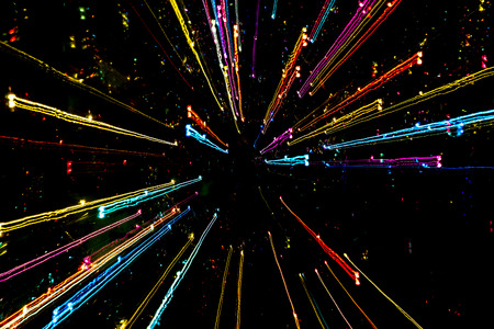 Multicolored luminous lines on black background