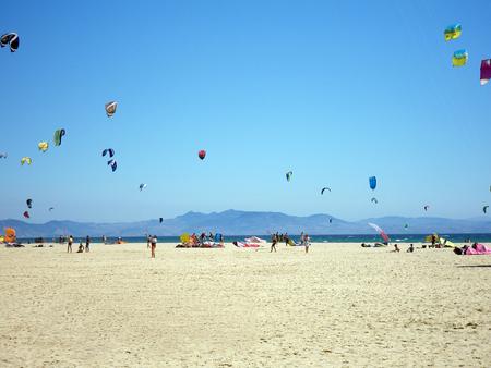 Kitesurfers on the beautiful beach of Tarifa. Spain Stock Photo