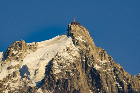 Aiguille du Midi in the light of the setting sun. Alps. Stock Photo