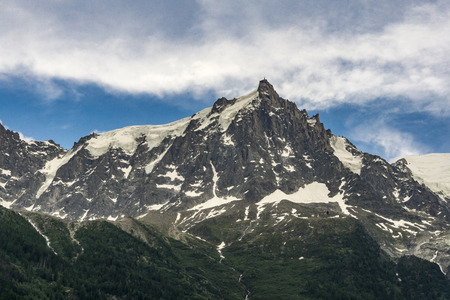Alps in June. View of the Aiguille du Midi in the Mont Blanc massif.