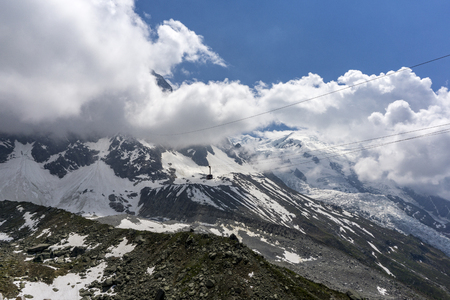 View of Mont Blanc massif and glacier in June. French Alps.