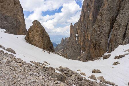 The rocky landscape of the trail on Sassolungo. Dolomites. Italy.