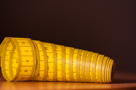yellow measure on table