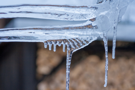 Close up of shiny and blue icicles with a dark background Фото со стока