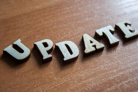 The word update made of wooden letters. wood inscription