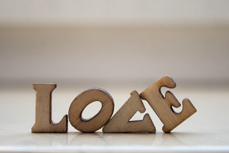 The word love made of wooden letters. wood inscription on white background Stock Photo