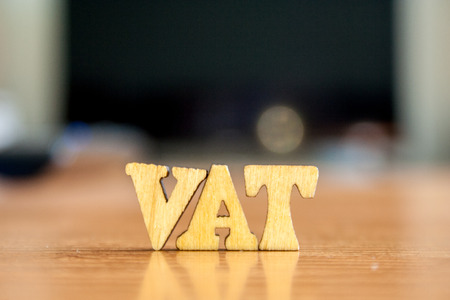The word vat made of wooden letters. wood inscription on table