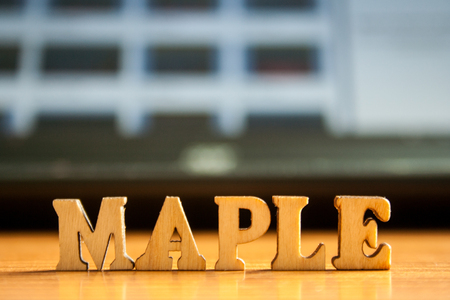 The word maple made of wooden letters. wood inscription on table Stock Photo