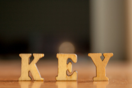 The word key made of wooden letters. wood inscription on table Stock Photo
