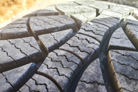 Close-up winter tire tread. Textured tire tread. Part of brand new modern winter car tire.