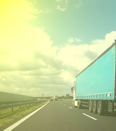 trucks carrying motorway loads.  concept of heavy transport, international transport and courier parcel transport.