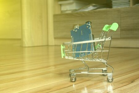A mini shopping trolley with an arduino board as a concept of purchasing electronic components.