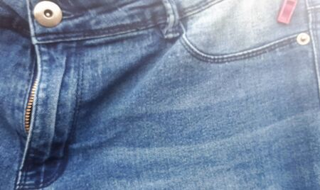 Background texture of blue jeans in blur. fabric on background