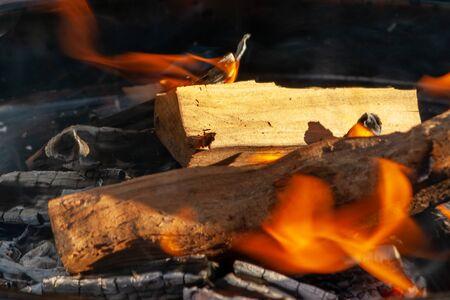 Danger wood and fire flame. Heat temperature. Danger fire. Foto de archivo