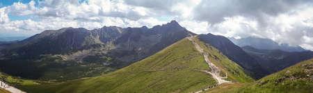 Summer panoramic view of Tatra Mountains, Kasprowy Wierch. Panorama landscape. Hiking concept scenery. Zdjęcie Seryjne