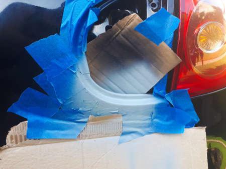 Peeled-off part of the car prepared for painting. Car paint repair. 写真素材