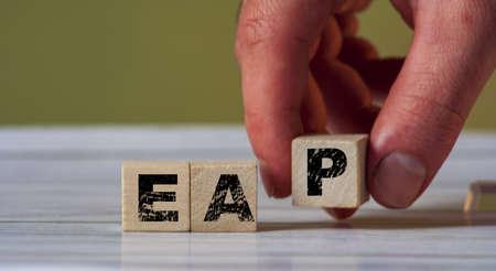 Cube block with the inscription EAP. Employee assistance program EAP symbol.