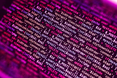PHP code on computer screen. Software development abstract background. Pink color. Search job or abstract course template for programming.