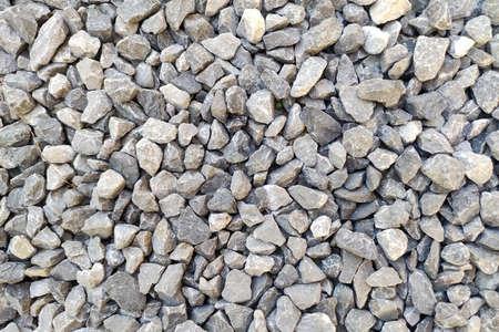 Gray gravel pattern texture. Small rocks closeup. Crushed stone surface background 版權商用圖片