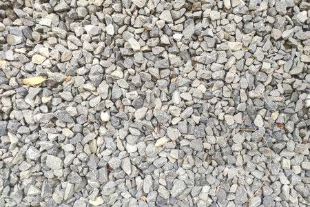 White gravel texture. road stone background, dark gravel pebbles stone texture 版權商用圖片