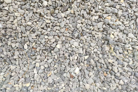 White crushed stones texture. Gravel background pattern