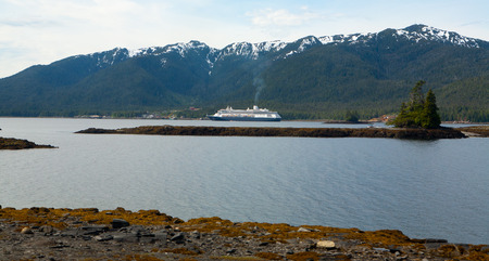 Cruise ship in front of Alaska mountains during summer