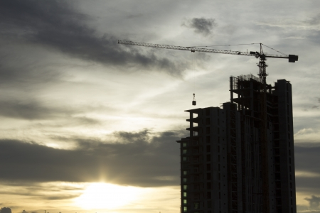 Building crane and building under construction against Sunset Stock Photo - 15494008