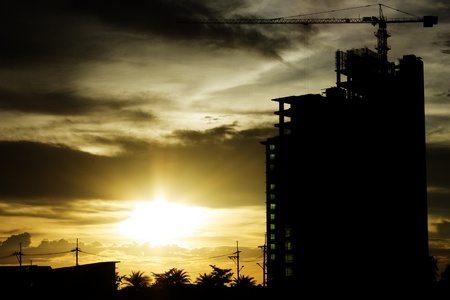 Building crane and building under construction against Sunset Stock Photo - 15493990