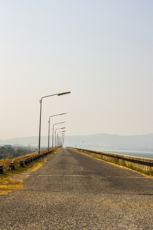 local road beside a dam in mountain and hot weather Stock Photo - 25035839