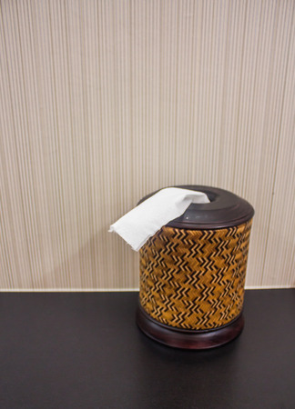 White tissue box on wooden table. photo