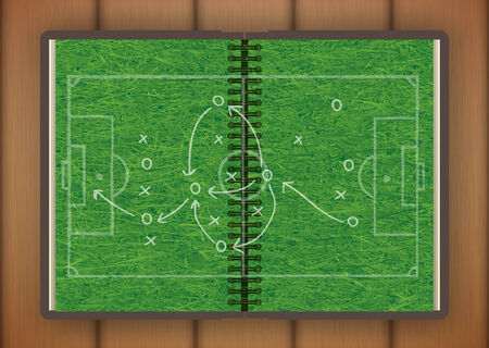open book with grass drawing a soccer game strategy. illustrated concept