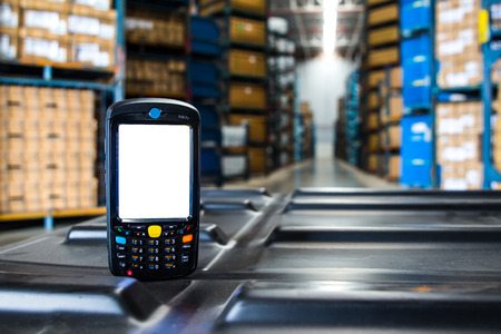 barcode scanner in front of modern warehouse Stockfoto