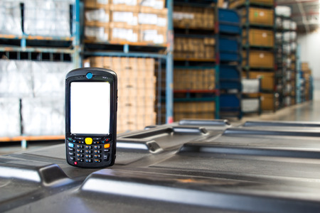 electronic store: barcode scanner in front of modern warehouse Stock Photo