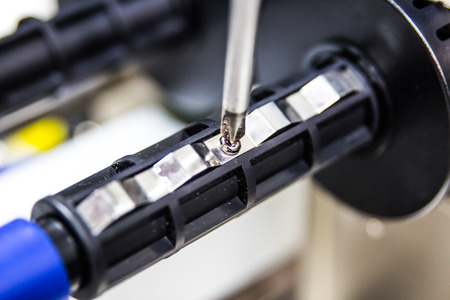 servicing: Technician servicing using screwdriver