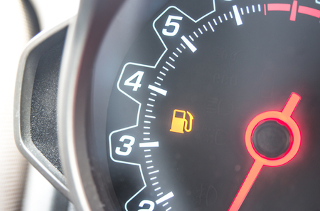 Out Of Gas - A car's gas tank is nearly empty.