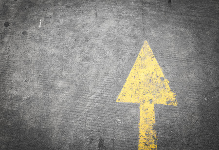 start to cross: yellow way arrow pointing in directions symbol on a ground road surface