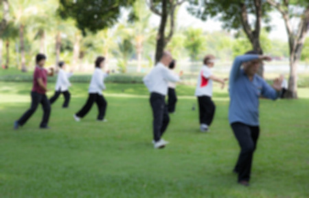 Style blur People practising tai chi in the park Imagens - 39929198