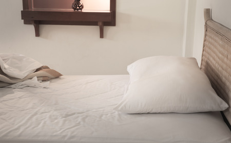 unmade: An unmade bed with white linens Stock Photo