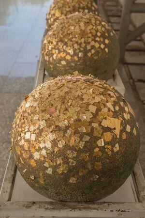 Gold leaf on loknimit (golden sphere) in Thai temple