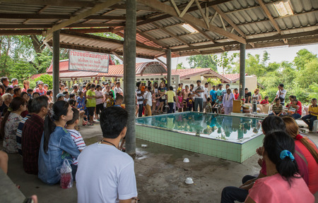 floating on water: SUPHANBURI, THAI - AUGUST 19 : Holy ceremony in traditional Floating water nun  for Pray