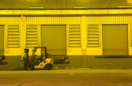 warehouse: Warehouse with yellow lights at night