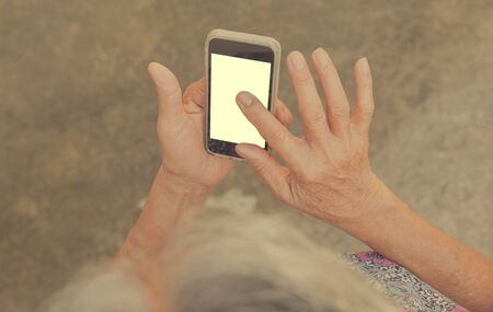 superannuated: Woman elderly Using a Smart Phone.
