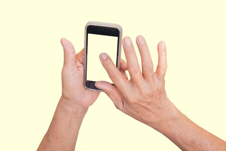 superannuated: Hand woman elderly Using a Smart Phone.