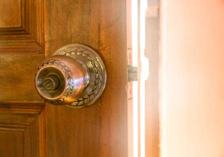 Old style door open door light Standard-Bild