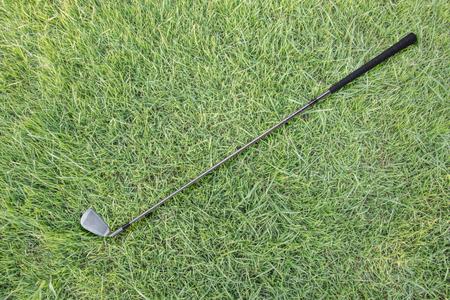 caddie: Golf club on green grass Stock Photo