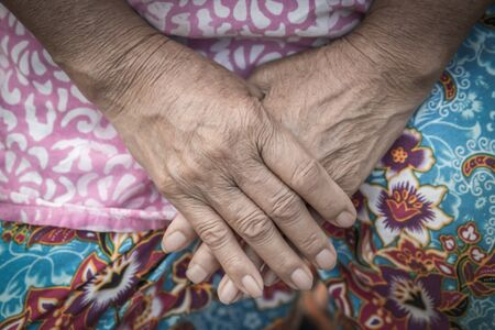 aging skin: Aging process - very old senior woman hands wrinkled skin