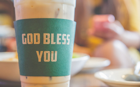 god bless: Iced coffee god bless you with milk is on the table.